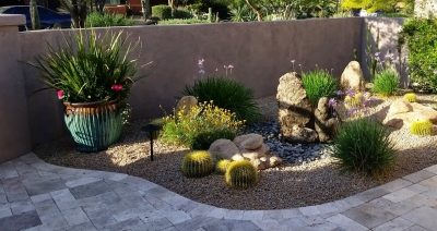Adding a small free-form water feature to your courtyard makes a unique addition to Scottsdale landscaping.