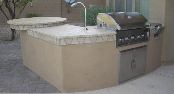 For their unique, new BBQ island, Glendale, AZ clients chose a stucco base that matches the home and a lovely natural stone top.
