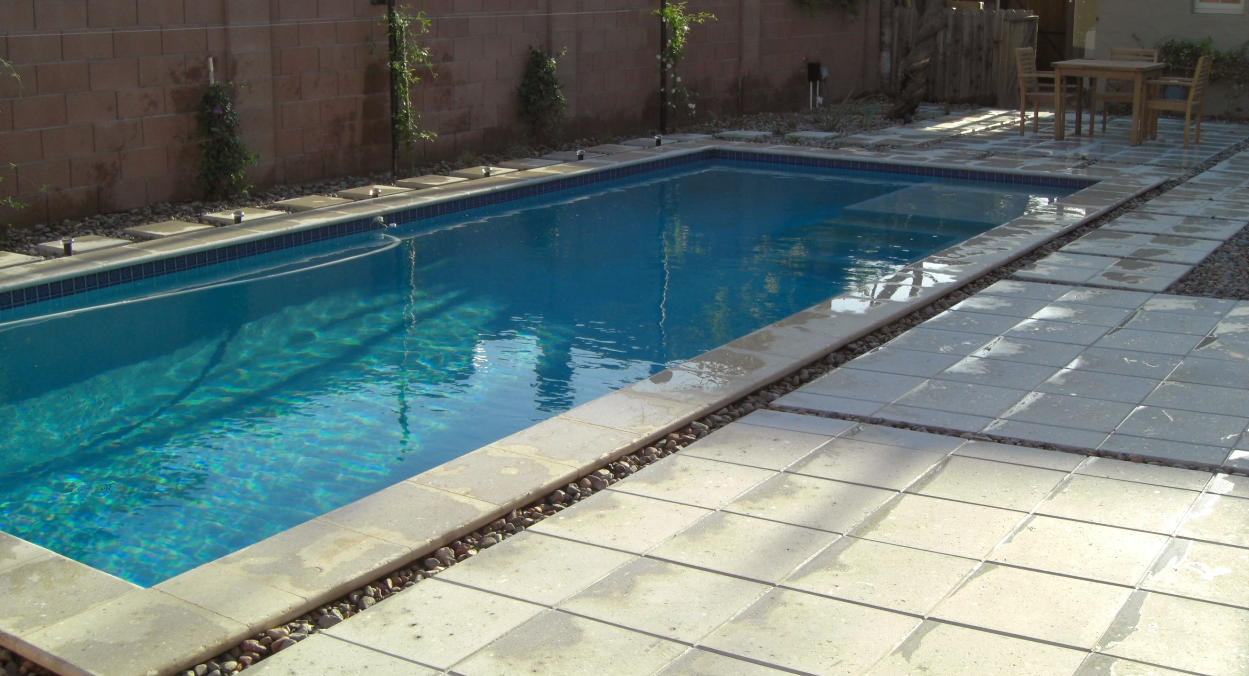 Landscaping on a budget does not mean you can only have Kool Deck. Working with Desert Crest, your Scottsdale, Phoenix, or Glendale pool deck can look far better, like this modern, geometric design we did for a client with a tight budget.