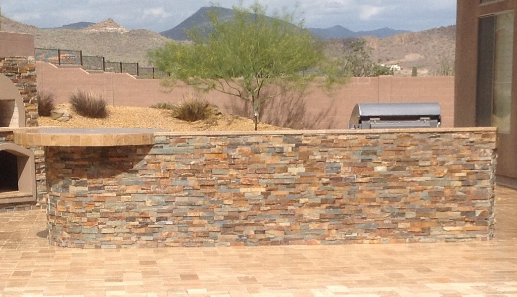 Beautiful split stone veneer wraps all sides of this Anthem outdoor kitchen.