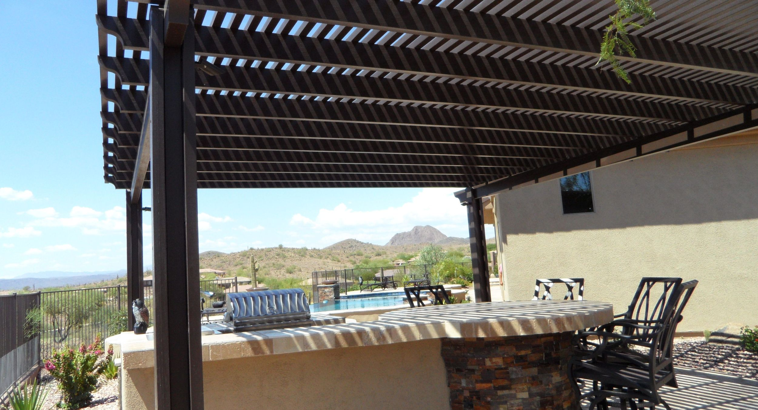 Don't sacrifice shade to keep the cost your patio down. Get the look of wood shade structures with aluminum pergolas. Phoenix and Scottsdale homeowners, you can have instant shade for less that looks great and is built to last.