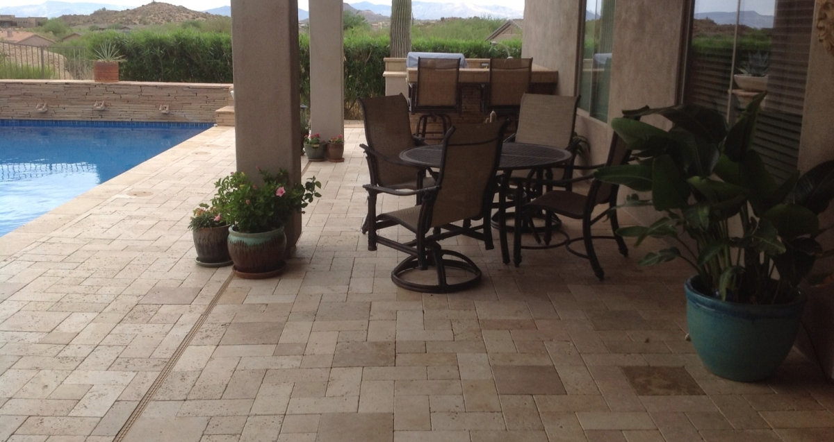 Merging patio and pool? Go for low-maintenance beauty like this travertine pool deck, Phoenix - Scottsdale.