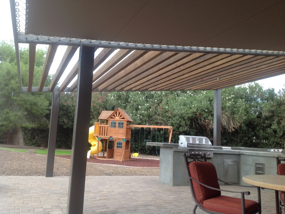Innovations at Desert Crest include our Sunbrella roof shade structures. Scottsdale clients have these running the full length of the patio.