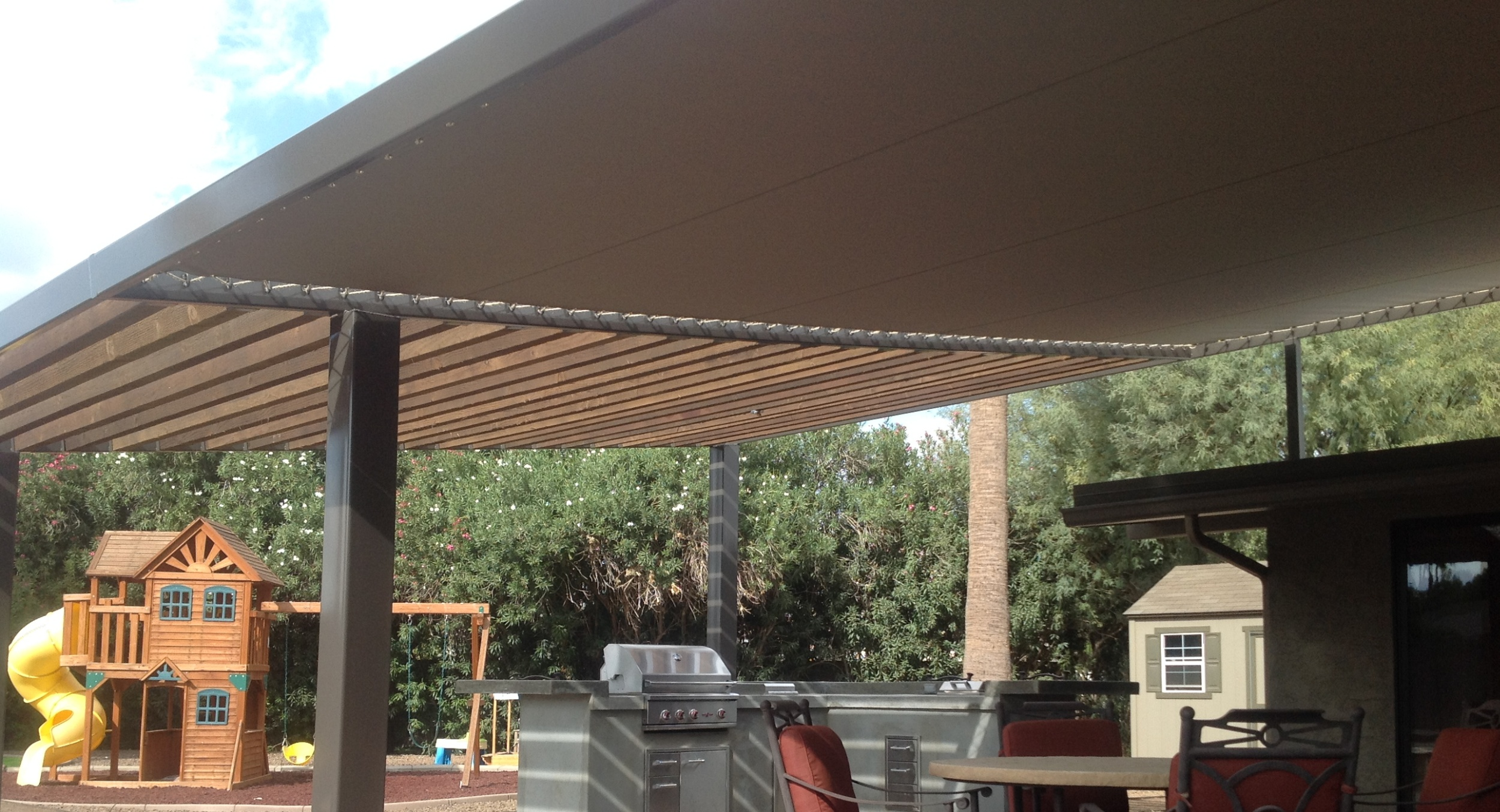 Solid roof pergolas cast way more shade that slat roof versions. Our custom Sunbrella roof pergolas, Scottsdale clients had us design and build will give them tons of shade for decades to come.
