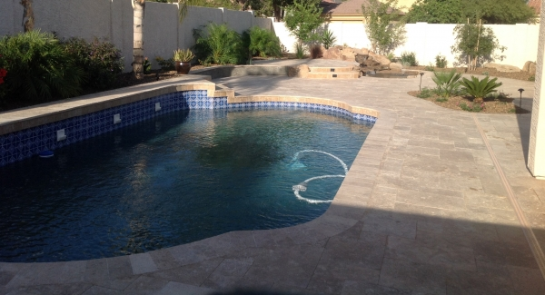 Another fantastic looking pool remodel. Glendale clients wanted the cracked, outdated kool decking gone. We used mixed sized walnut travertine in the Versailles pattern. It's not looking over the hill anymore.