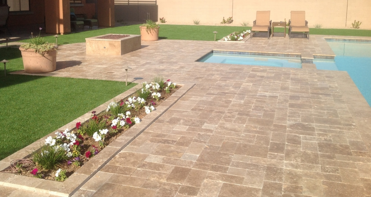 Colorful flowers, drought tolerant plants, and synthetic grass landscaping. Phoenix patios that give you more spare time to enjoy it all.