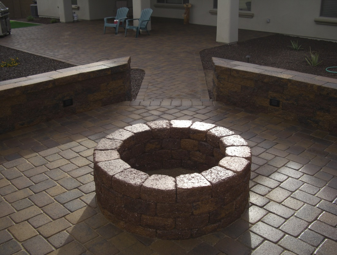 Brown Versi-Lok wall stone wood-burning fire pit and seat walls looks great with the London Cobble pavers we used in this client's Glendale landscaping.