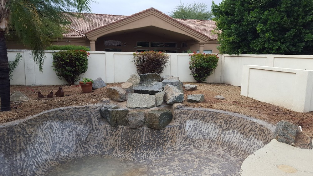 The pool area made the backyard look pretty bad before this swimming pool remodeling. Scottsdale clients were excited to see the last of it's dilapidated ugliness.