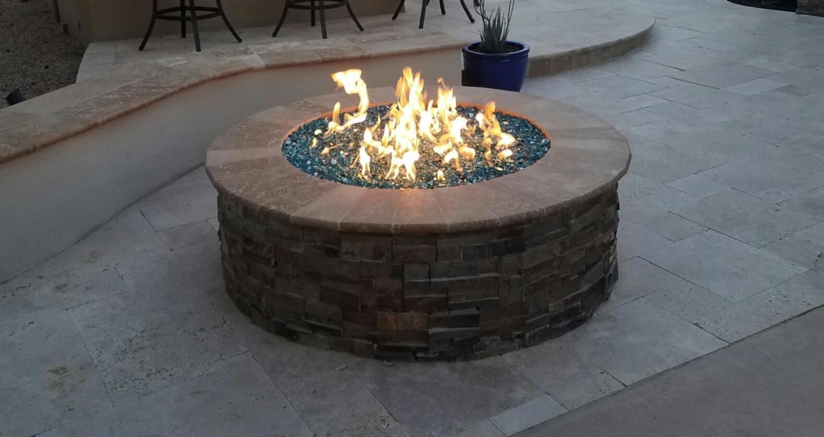 Glam for the Hearth; glittering glass fill is the latest Phoenix fire pit design trend.