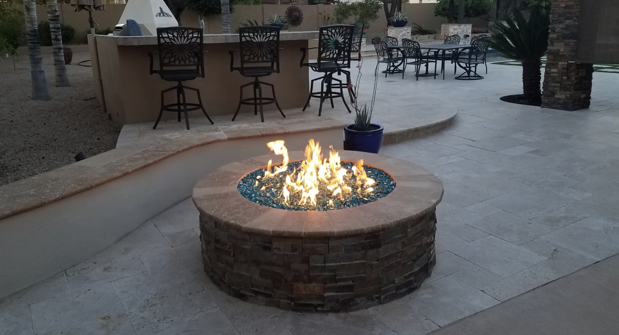 Beautiful color from Fire Glass fill makes Scottsdale and Phoenix fire pits a gorgeous patio element around the clock.