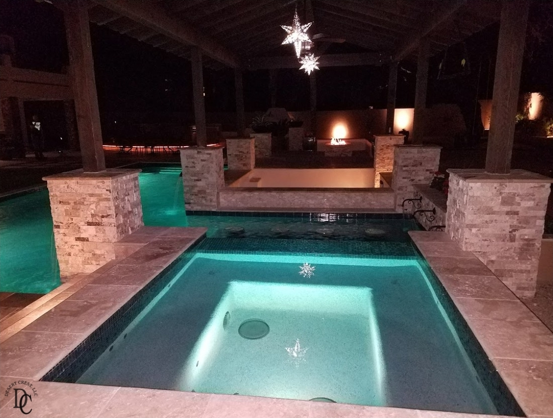 New Peoria pool installation features lighting both in the water and under the roof of the dark timber ramada.