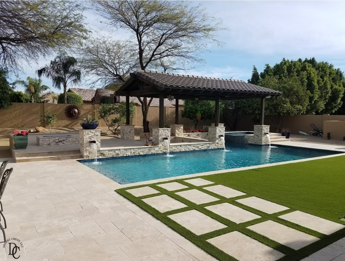 Gorgeous new pool installation! Peoria, AZ homeowners chose split face travertine stone veneer to face the pillars, fountain wall, and spa walls.