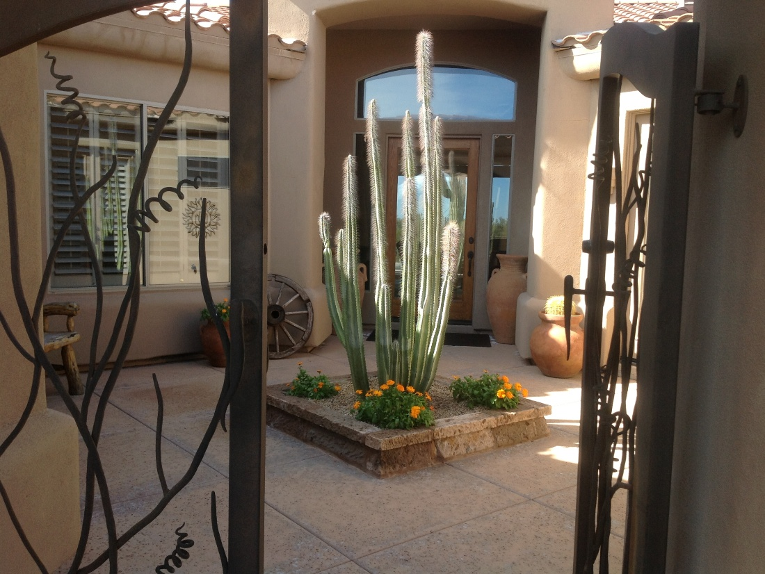 Large cantera stone tiles create an clean, sophisticated outdoor floor in this Scottsdale courtyard design.