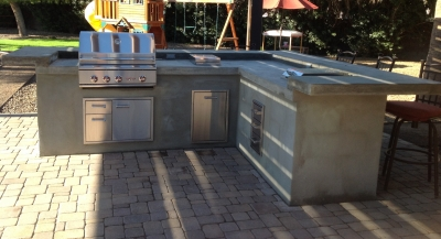 Concrete counters are super popular, and the trend moves to built-in grills. Paradise Valley clients had us create this lovely outdoor cooking center that will soon have a cabinet clad in wood and metal.