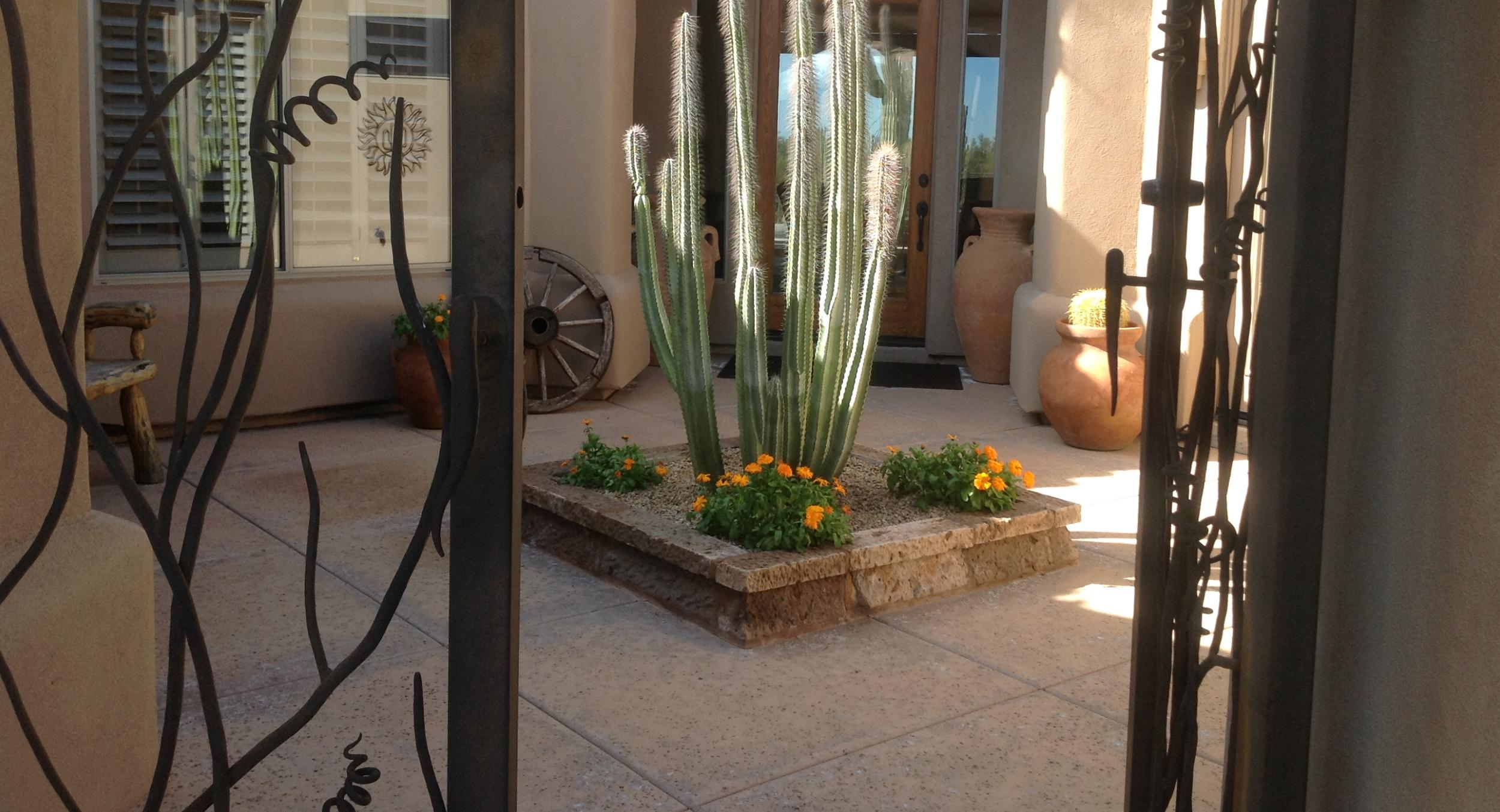 The understated elegance Cantera stone is amazing. The perfect floor material in this courtyard landscaping, Scottsdale installation by Desert Crest.
