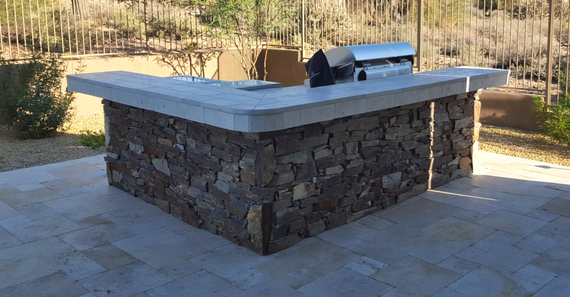 Gorgeous color and texture on the seating side of the new natural stone patio bar and grill Scottsdale clients had Desert Crest build.