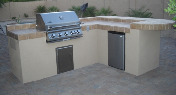 Cooking out gets so much more convenient with a built-in BBQ island. Phoenix, AZ clients chose tile and stucco for this custom design by Desert Crest..
