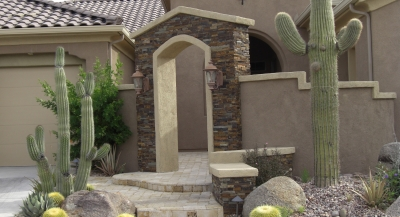 A beautiful combination of stucco and natural stone courtyard design. Anthem landscaping by Desert Crest LLC.
