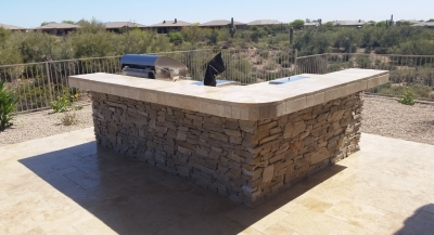 Travertine counters and rustic stone bar - BBQ island: Scottsdale.