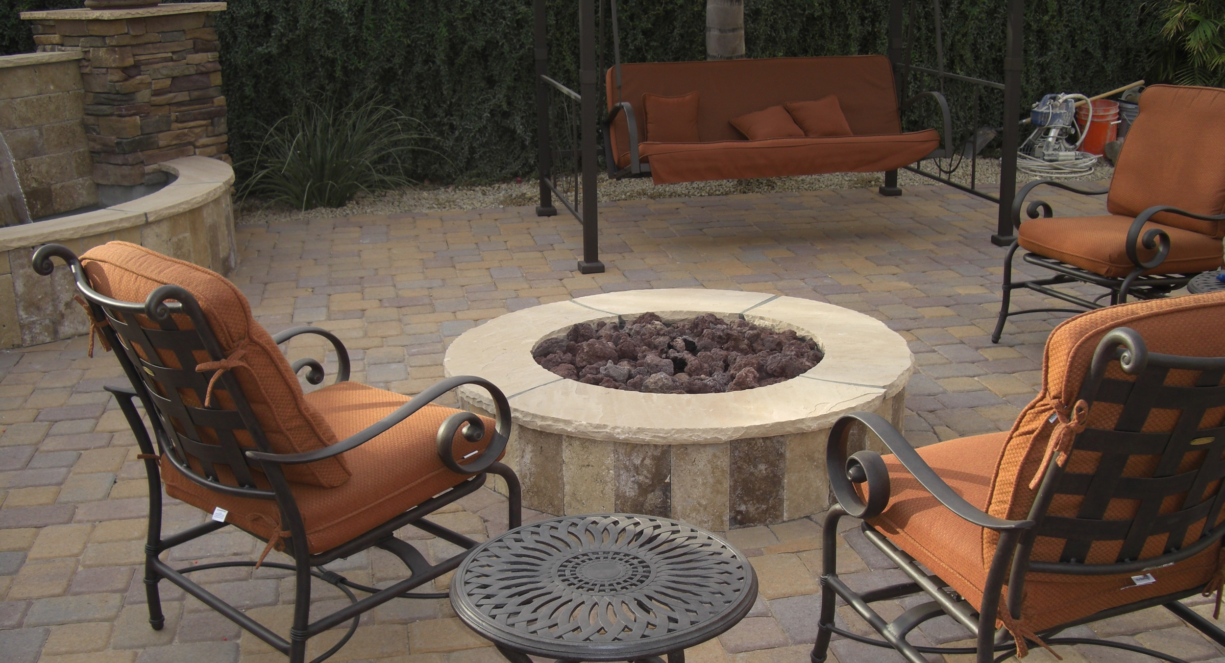 Even small patio designs give you room for outdoor fire pits. Glendale clients now enjoy this lovely stone fire pit and matching waterfall fountain on their new paver patio.