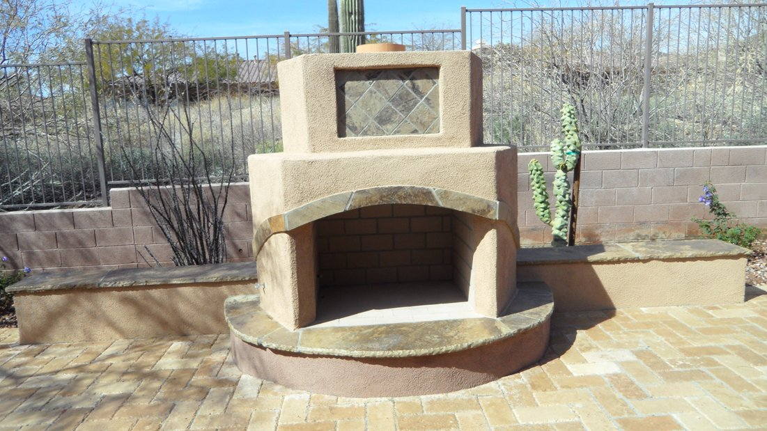 Most designs for Anthem outdoore fireplaces are geomentric, but this client chose a 6-sided model. Challenging to build and looking good with flagstone inlay work to pull their new raised spa into the patio's overall design.