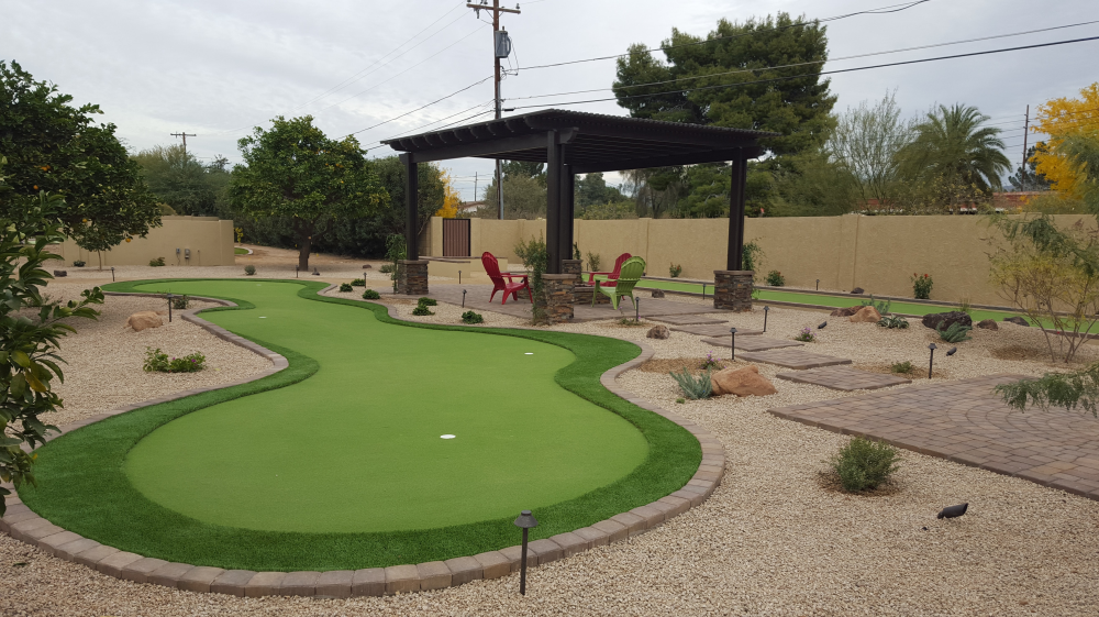 Turning lots of wasted space into a backyard game space completely altered this yard. New ways you can benefit from synthetic grass! Scottsdale landscaping.can have so much value beyond aesthetics..