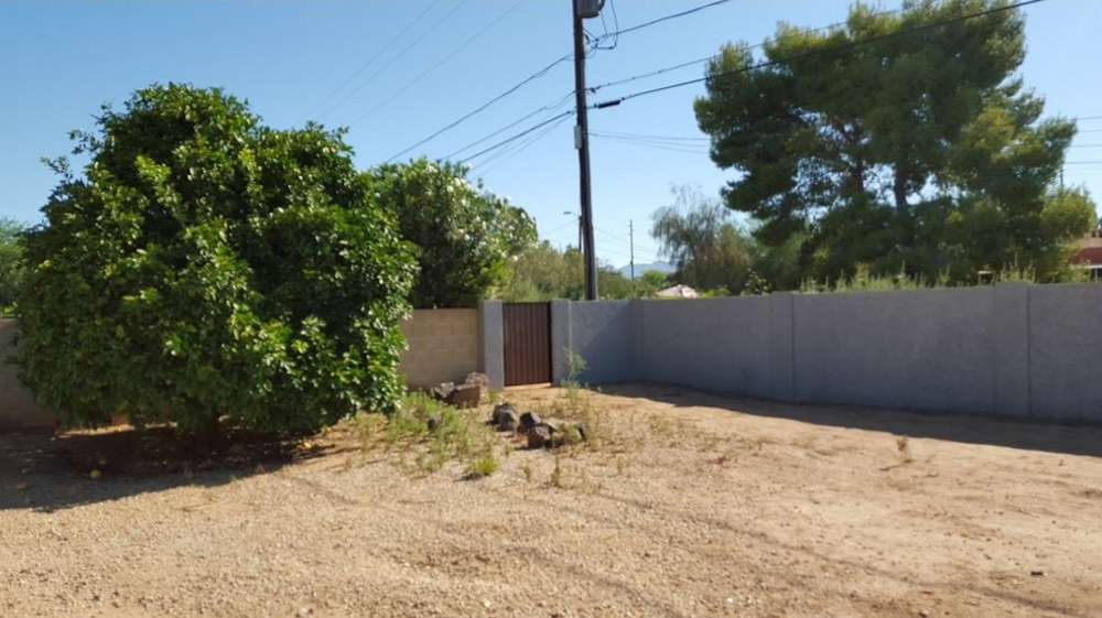 Before we put in the new backyard bocce ball court, Scottsdale homeowners had a huge area of barren, wasted space in their yard.