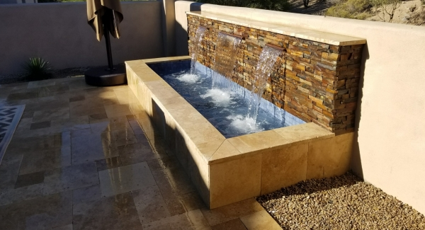 Anyone can enjoy their own outdoor fountain. Scottsdale, AZ condos and small backyards have plenty of room for a narrow basin with multiple channel waterfalls. Simply beautiful!