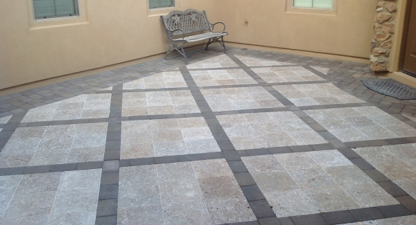 Create some excitement with your courtyard pavers, Phoenix. Inlay patterns and cut work designs can make residential paving unique. Here we mixed charcoal pavers with beige travertine for a trellised effect with a wide dark border around the courtyard's perimeter.