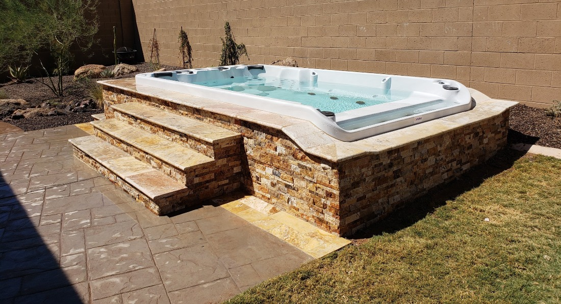 Gorgeous stone swim spa surrounds. Athem, AZ client has this beautiful travertine design on their huge swim spa. Looks great with the patio and landscaping.