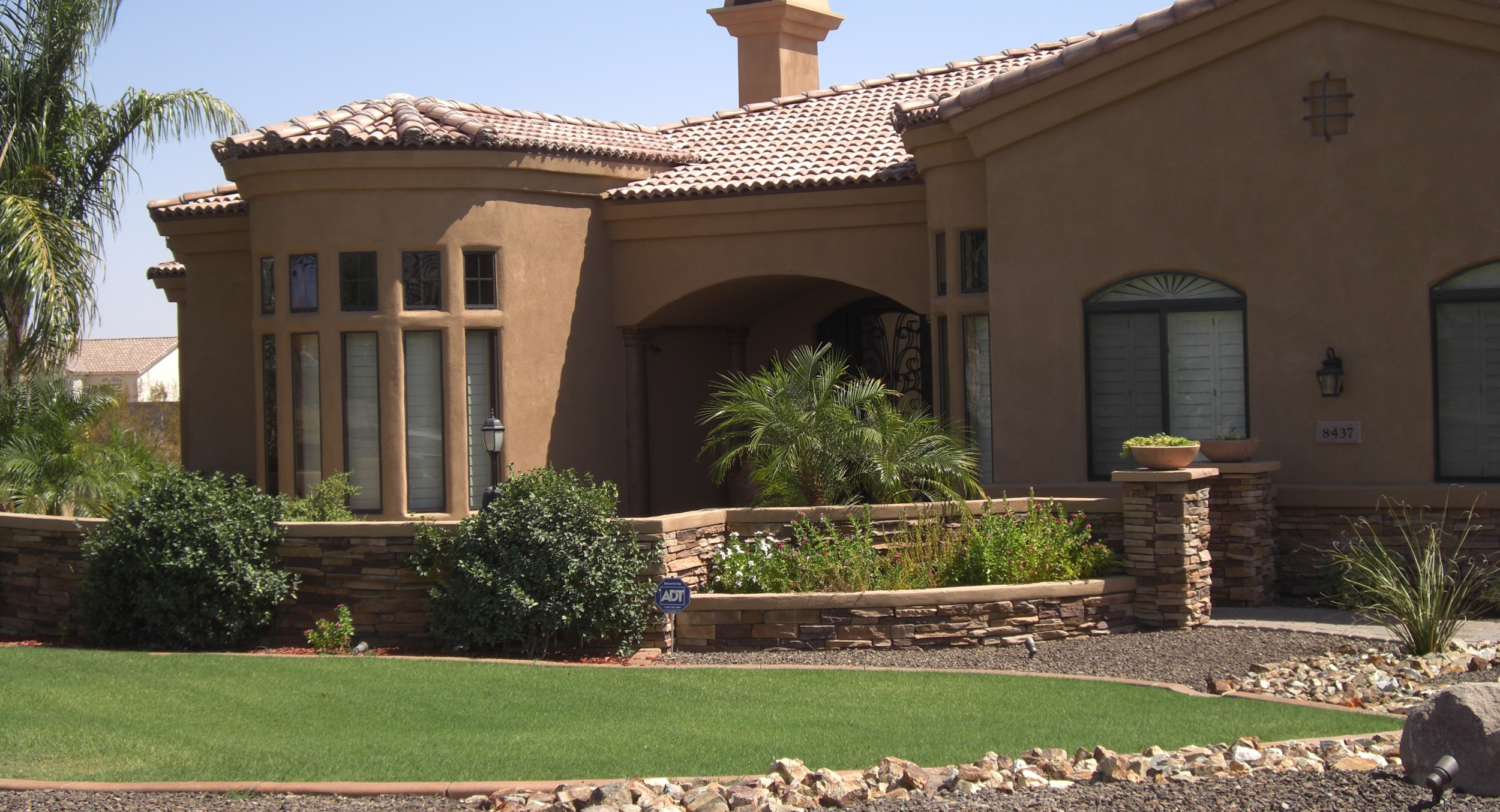 We are especially fond of grass here at Desert Crest, so this Glendale lawn's installation in front of our stone courtyard walls was pure pleasure. It makes our stone work look spectacular.