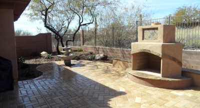 Looking for unique outdoor fireplaces, Anthem? This modern 6-sided design in stucco with Autumn Blend flagstone inlays may interest you.