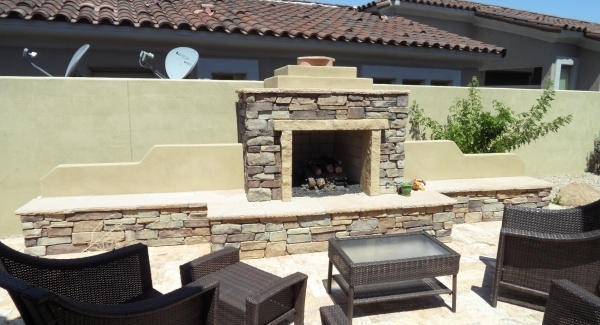 Get more from Arizona backyard living with outdoor fireplaces. Phoenix patio designs by Desert Crest often feature stone masonry like this natural stone example.