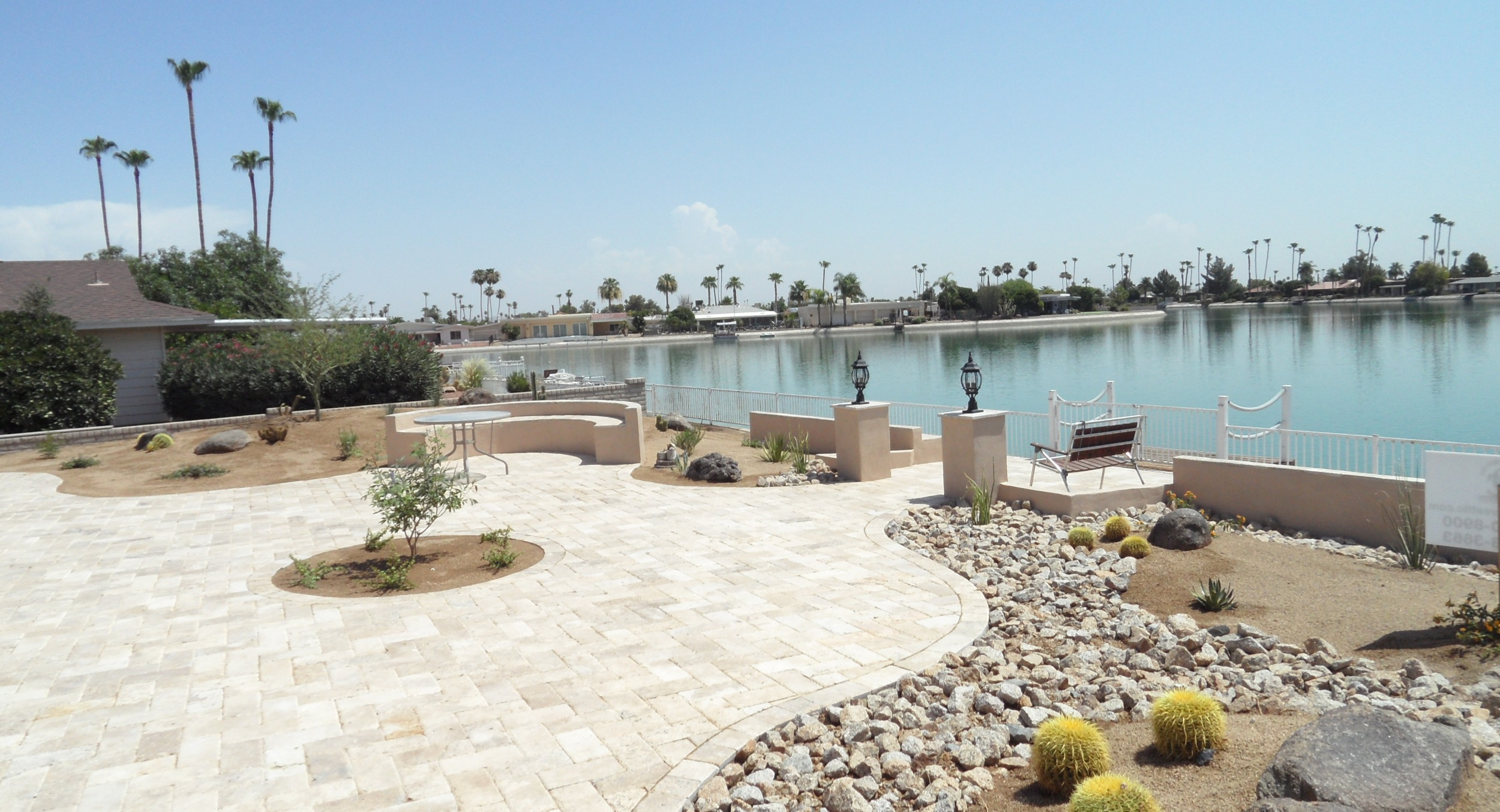 Waterfront living means having lots of space for outdoor entertaining, especially in the desert. These homeowners have plenty of room now with their light travertine patio design. Sun City landscaping is low-maintenance to allow them a nice yard that doesn't take up their time.