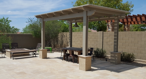 You can have great shade for less from beautiful patio shade structures. Anthem, AZ landscaping clients chose a light finish for their new aluminum pergola. A great color on their new travertine patio.