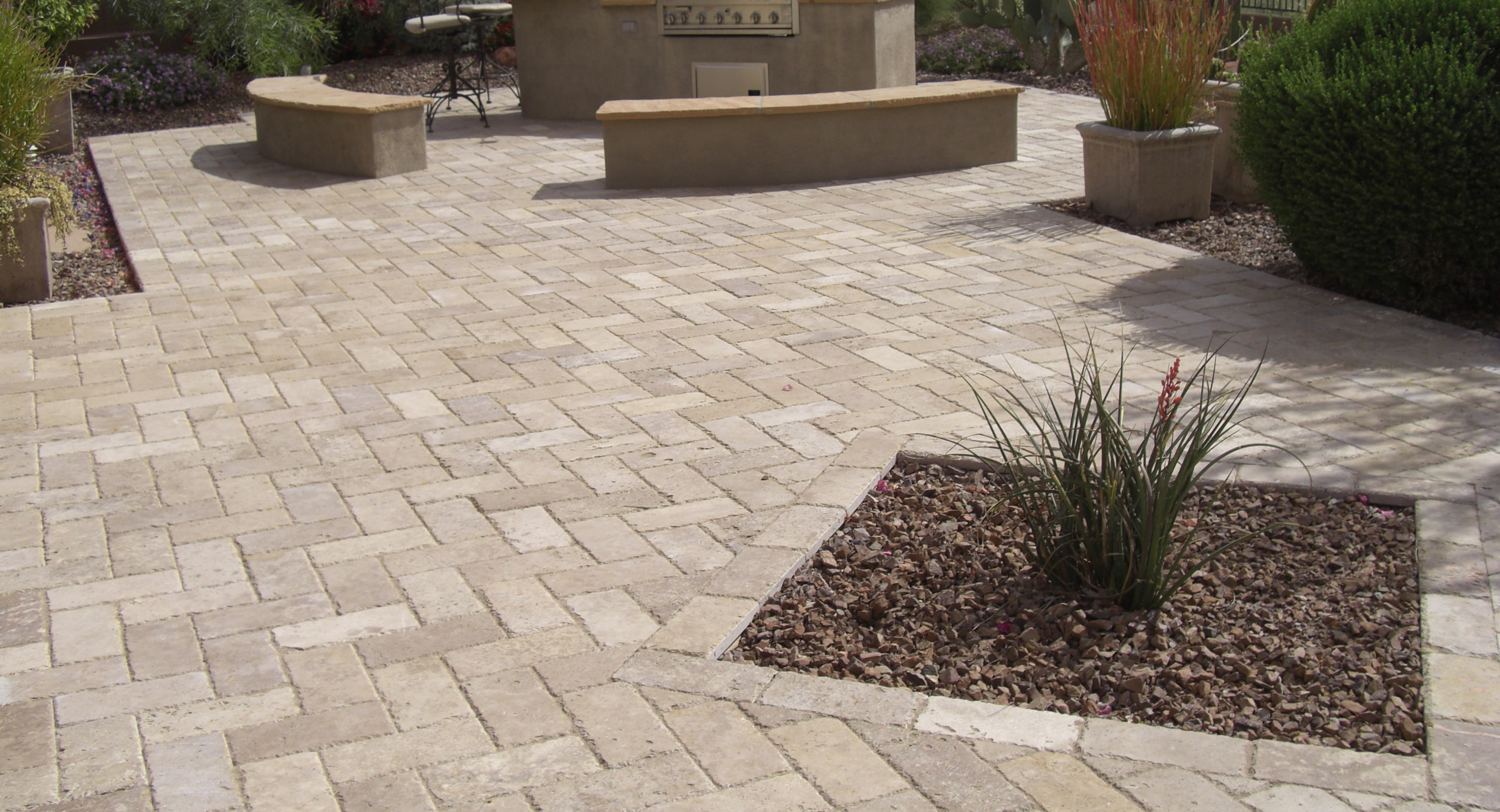 Travertine makes beautiful paver patios. Peoria, AZ landscaping for this Desert Crest client included this spacious outdoor living space with chisel travertine in a brick shape.