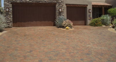 Make a gorgeous home a lot more striking with driveway pavers in Phoenix, Scottsdale, or any other up and coming spot in the area. THe red and brown blend in this driveway make the rusty metal trim on the home twice as outstanding as it was with a concrete drive.