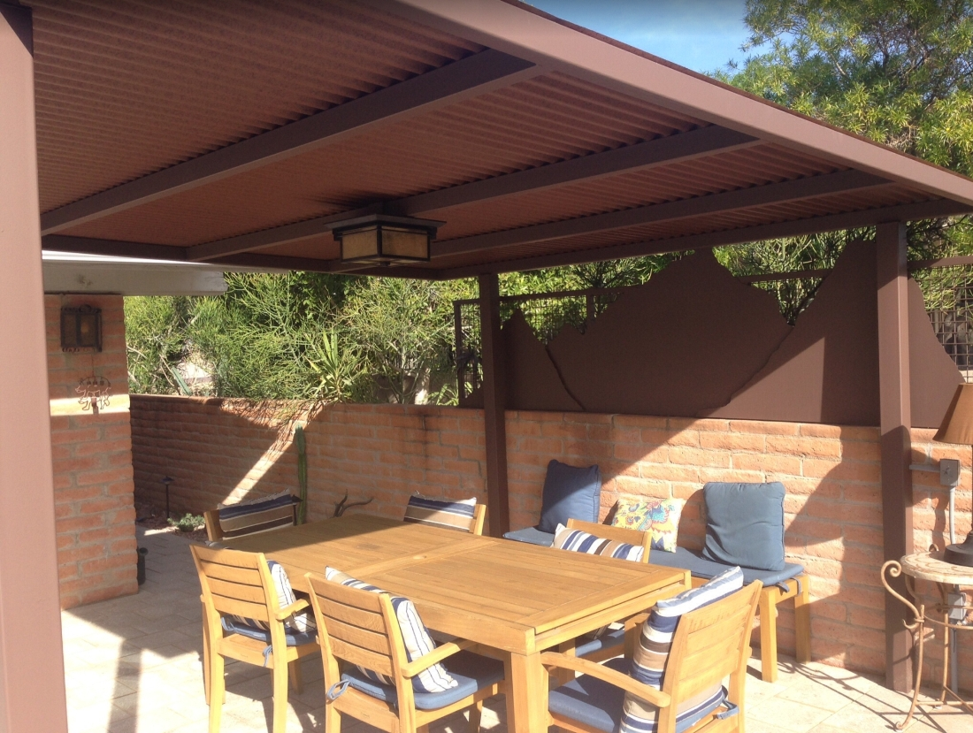 Modern rustic solid steel Phoenix shade roofs. Just what you need on your new patio. This client had us paint their's the color of rust to match some outdoor art.