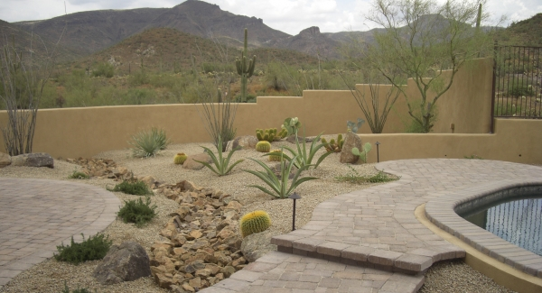 Enlarging this backyard to put in more patio and pool landscaping. Cave Creek clients had more property outside the original fence wall that we moved back.