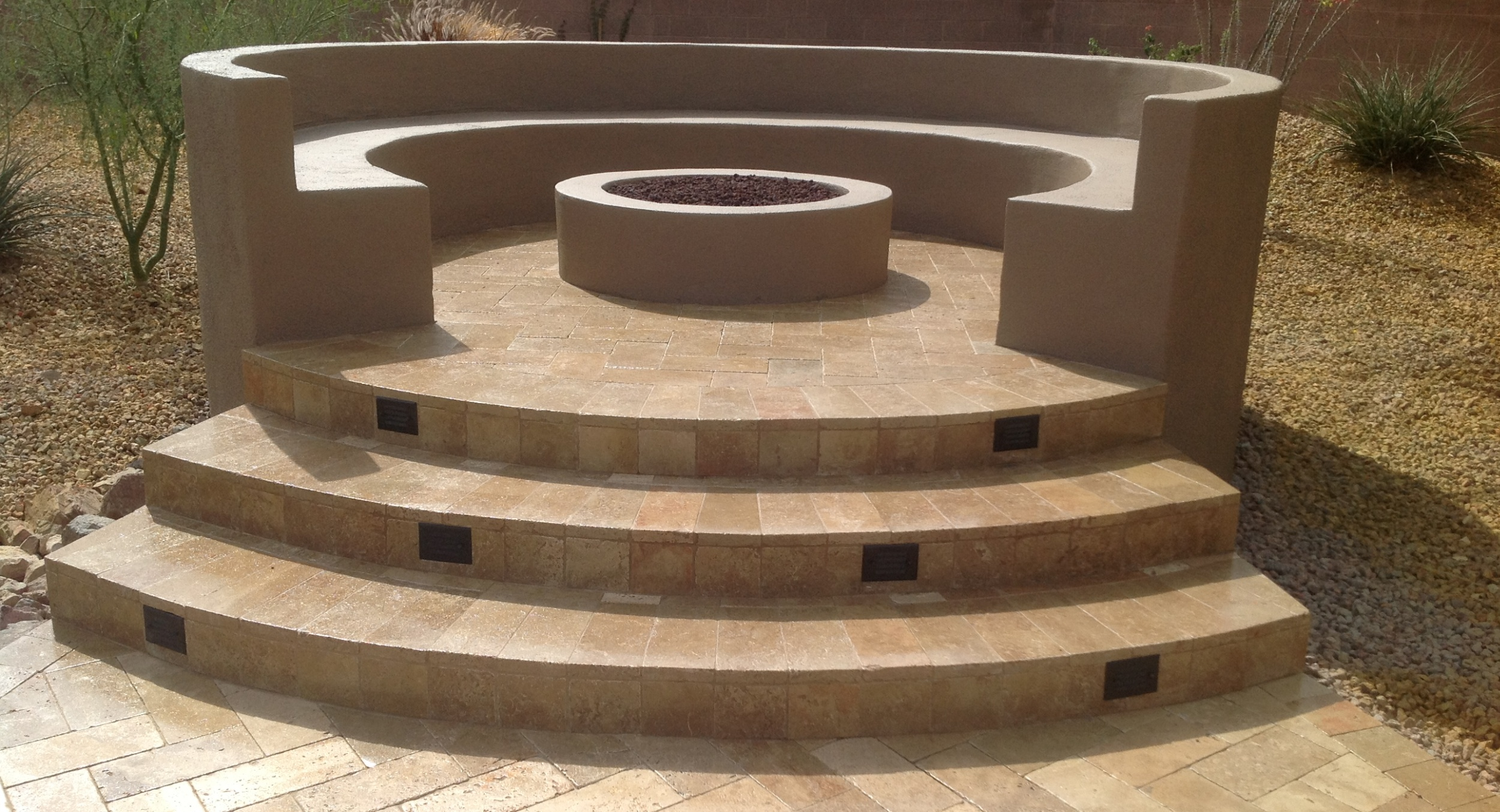 You'll never have to shift to escape wood smoke with gas fire pits. Anthem patio design clients opted for this raised stucco fire pit as part of their new paver patio design.