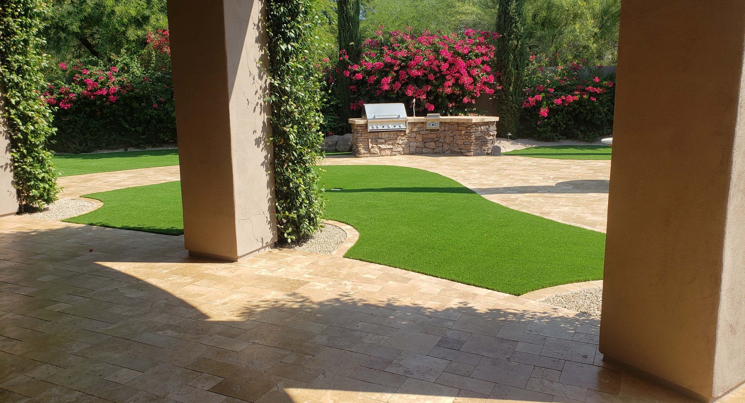 New home or updating an older one, beautiful surroundings come from solid Scottsdale landscape design. Here we updated this gorgeous property with travertine pavers, lots of synthetic grass, and in the spot - a built-in gas grill.