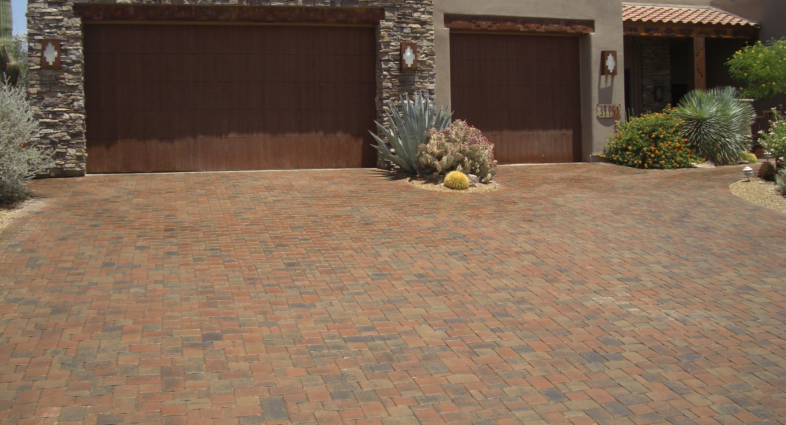 Take your pick between Scottsdale or Phoenix pavers and stone paving. The area being paved determines what material is best, like this driveway is done in pavers to bear vehicle weight better.
