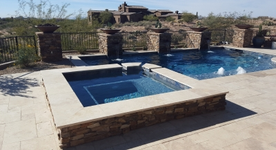 Does your pool company only install pools and leave you in need of another contractor for Scottsdale pool finishing? Desert Crest did all the stone veneer on this builders pool, along with a lovely travertine pool deck/patio.