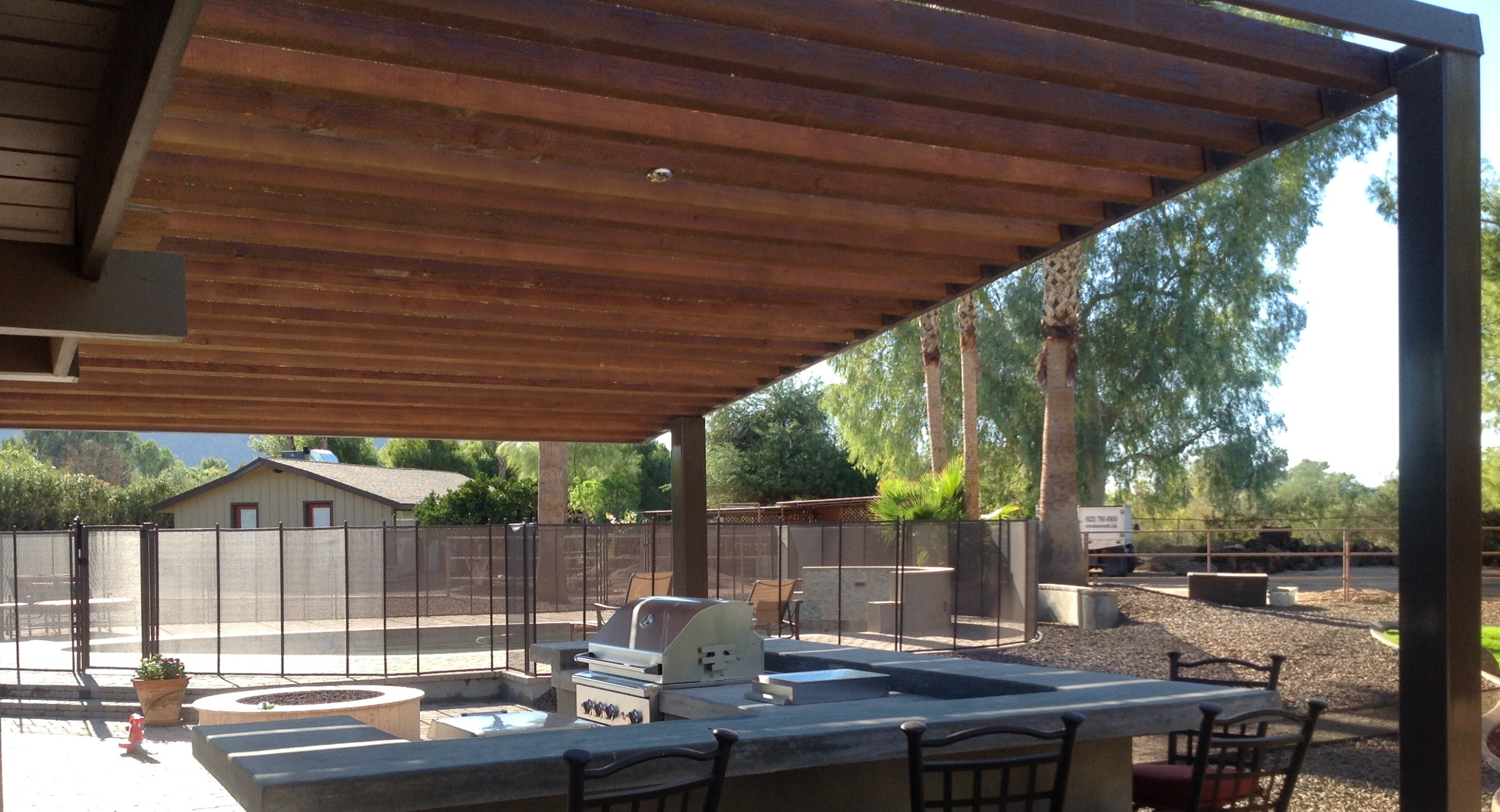 This specially engineered Scottsdale shade structure's a huge asset for this client's new built-in grill and bar area. Dense shade, not interrupted sunshine, makes for highly enjoyable Scottsdale patio design.