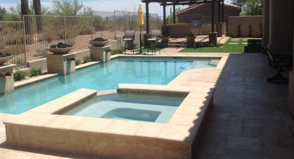 Backyard landscaping for this client is pretty extensive. The swimming pool sits just off the porch and occupies the whole center of the yard, so their Scottsdale travertine pool deck - patio is both large and beautiful.