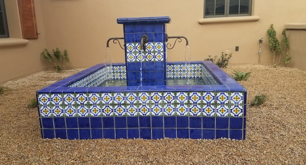 No question these Mexican tiles are hand painted, even the solid cobalt ones display that fact. Traditional outdoor fountains, Scottsdale AZ, add an artistic note to your courtyard or patio landscaping.
