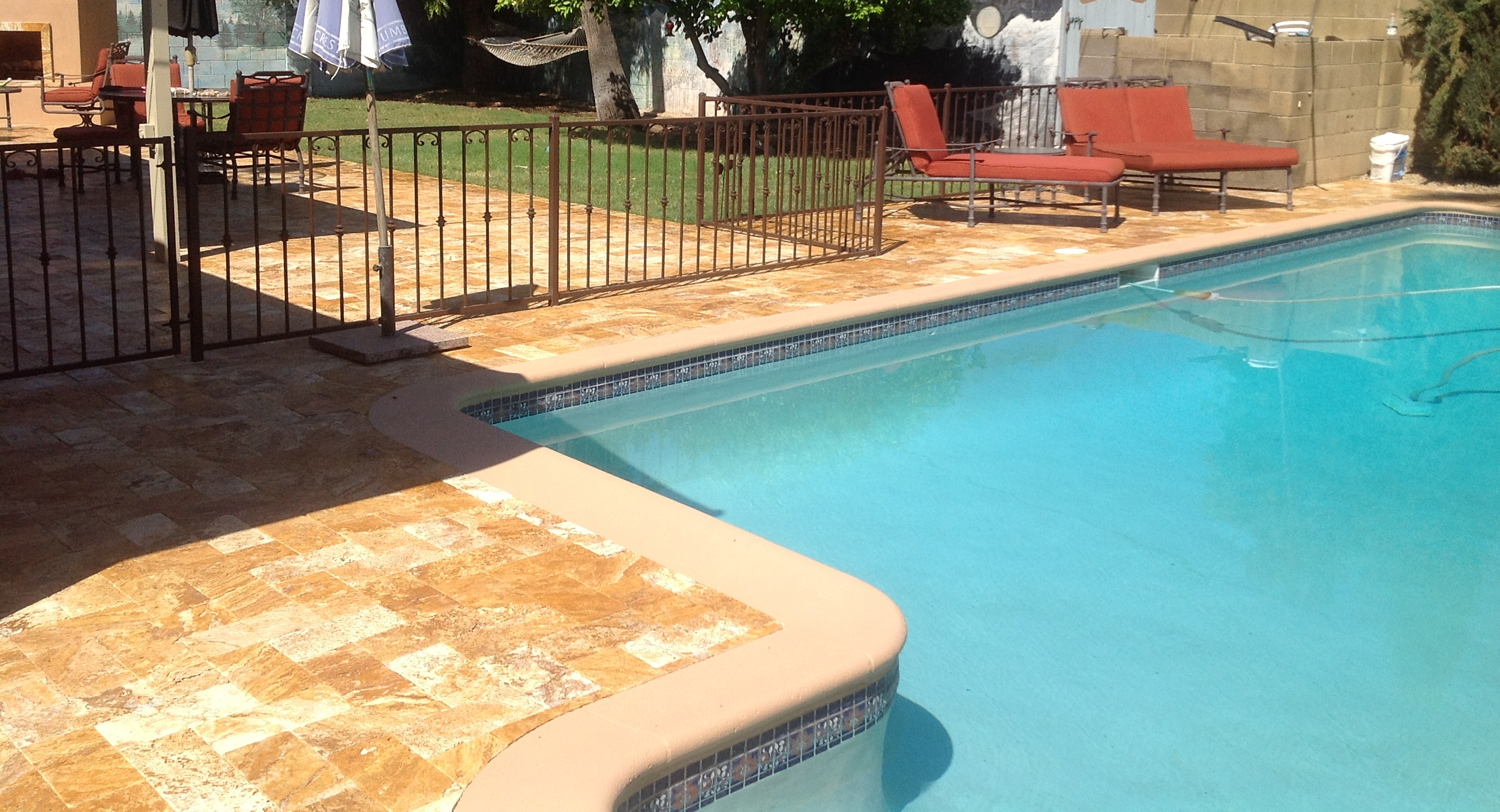 A dramatic change took place with this Scottsdale pool remodeling. We removed old, cracked and unsightly looking Kool Deck and replaced it with gorgeous travertine pool deck. Scottsdale clients are tickled with their new yard.