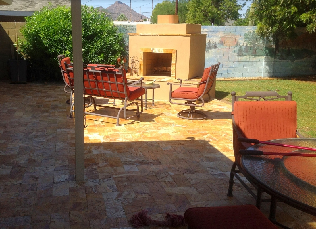 Our clients replaced all the backyard paving when redid the pool decking. This lovely outdoor fireplace is on the opposite side of their new travertine Scottsdale patio - pool deck space.