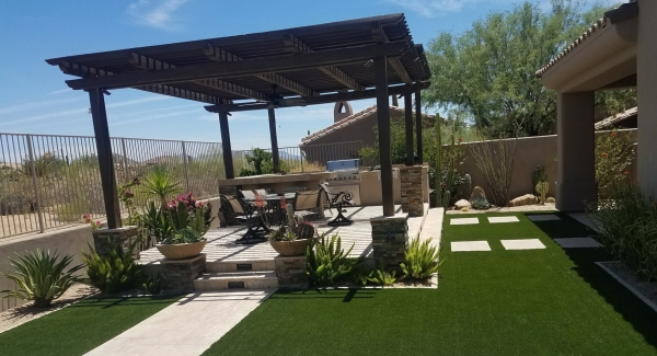 This dark stained wood shade roof created a dramatic look above the light travertine pavers used in this client's Scottsdale patio design.