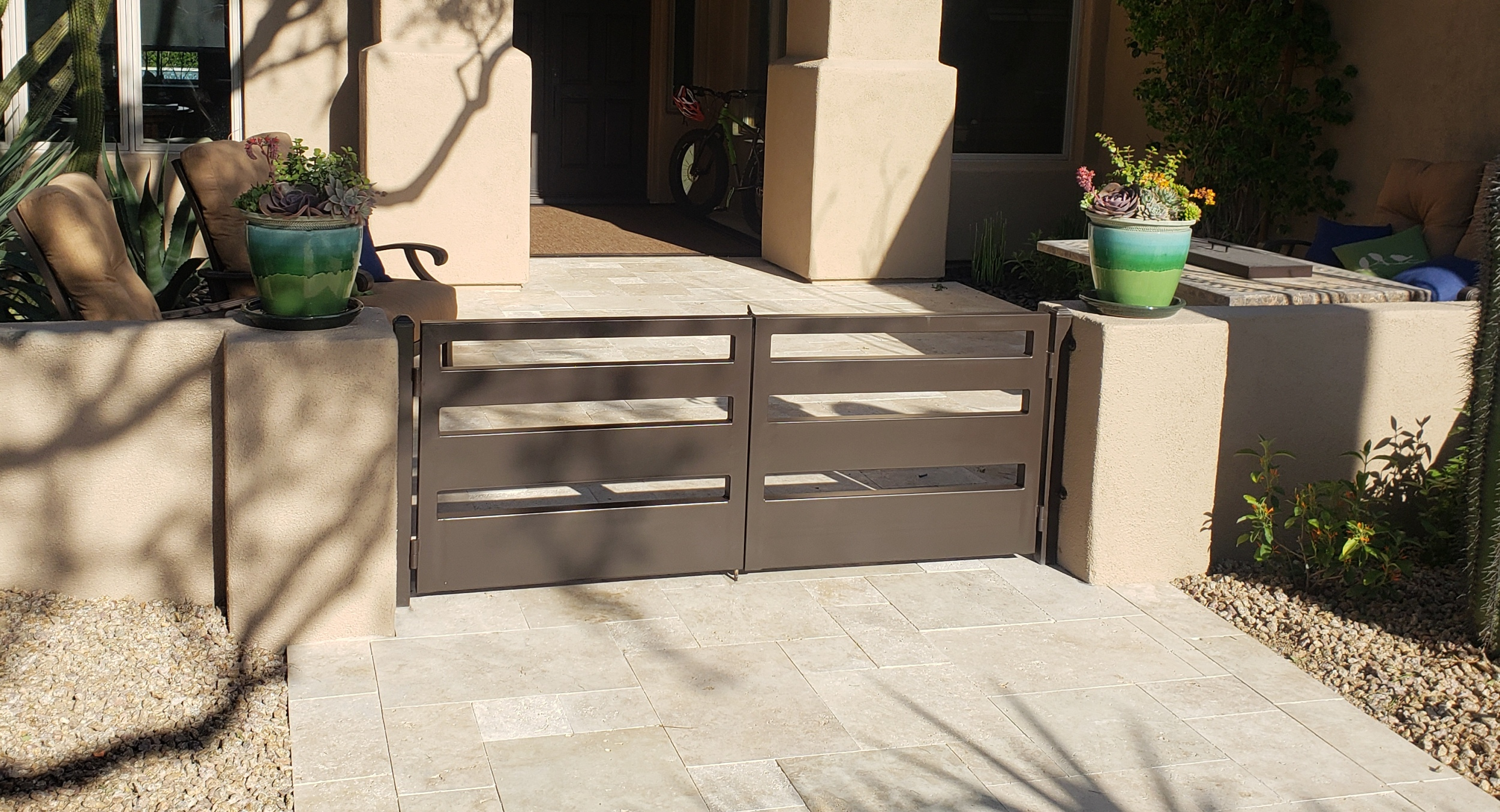 Got a lackluster approach to your front door ? Check out travertine pavers. Scottsdale clients had us swap out builder's concrete for beautiful travertine.